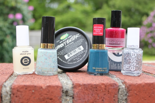 A collection of nail polishes from Revlon, Essie and others